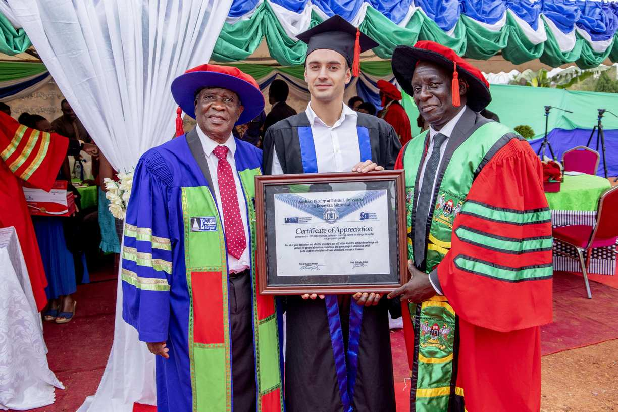 ECUREI International Student Milan Anusic hands over a certificate of appreciation from Medical Faculty of Pristina University in Yugoslavia to Proffesors Kawooya and Kasozi